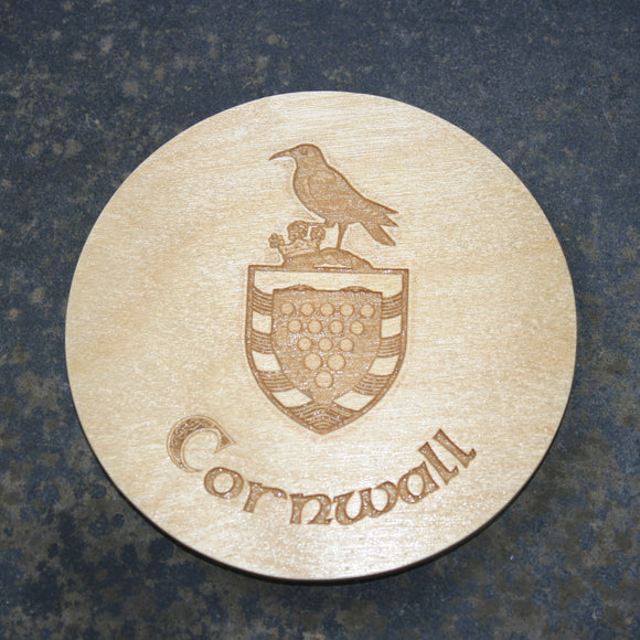 Wooden coaster with a Cornwall shield logo design