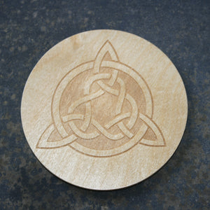 Wooden coaster with a Celtic tri-knot design