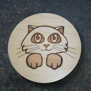 Wooden coaster with a cat head design