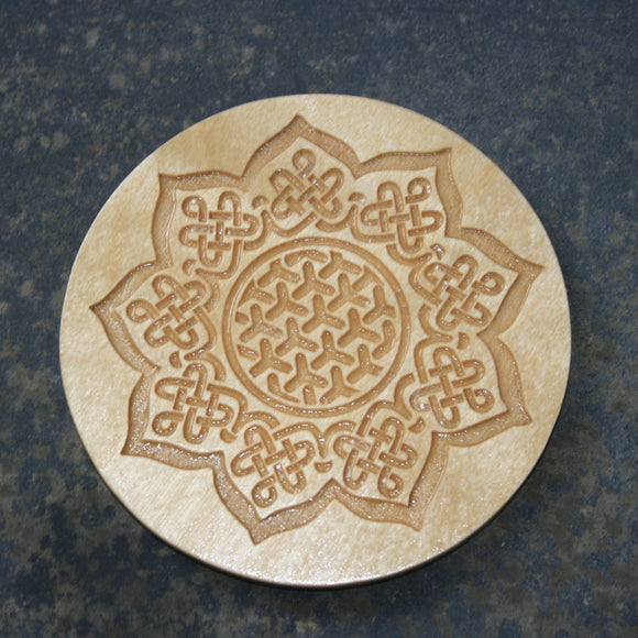 Wooden coaster with a Celtic sunflower design