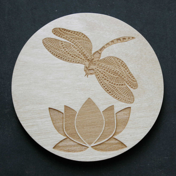 Wooden coaster with a dragonfly and lily design