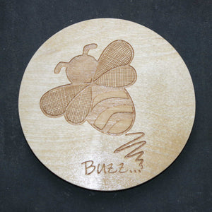 Wooden coaster with a bee design