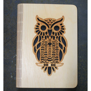 wooden note book cover with an owl design