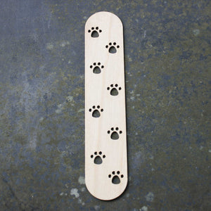 Wooden bookmark with a paw prints design