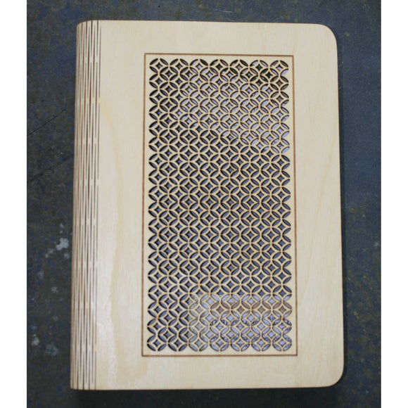 wooden note book cover with a round lattice design