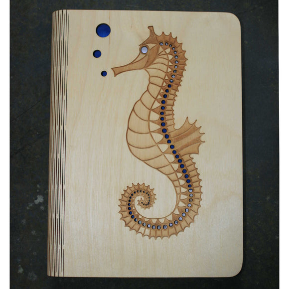 wooden note book cover with a seahorse design