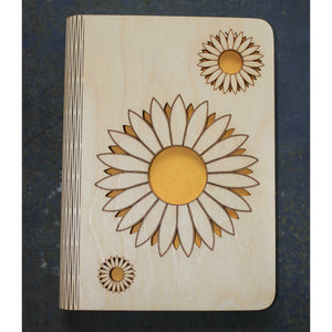 wooden note book cover with a sunflower design