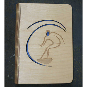 wooden note book cover with a surfer on a wave design