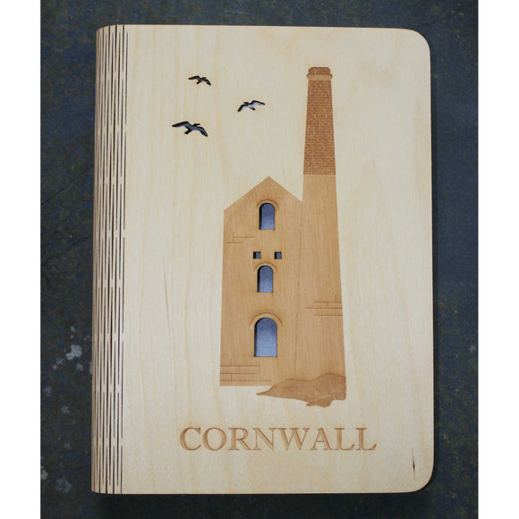 wooden note book cover with a tin mine design