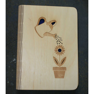 wooden note book cover with a gardening design