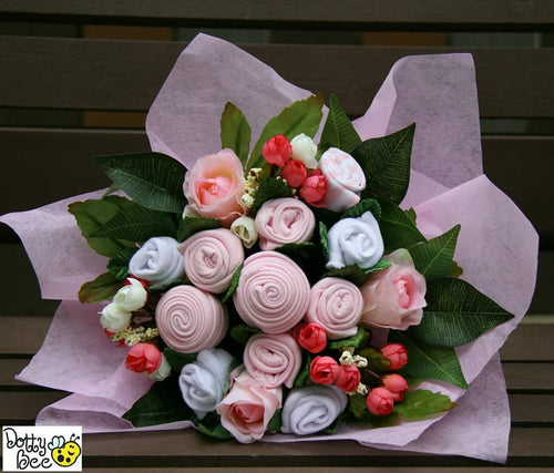 An Adorable Sugar Pink Baby Clothes Bouquet