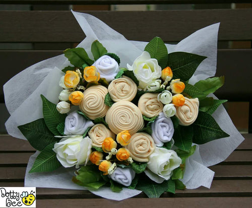 A Fabulous Neutral Yellow Baby Clothes Bouquet