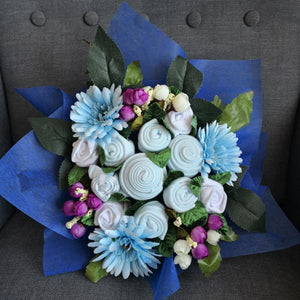 A Royal Blue Baby Clothes Bouquet