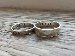 Matching silver ring bands with secret stamped message inside