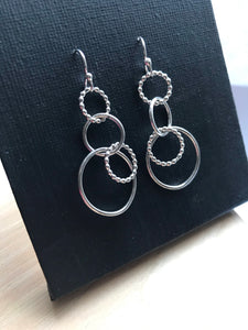 Silver circles dangle earrings