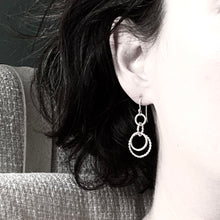 Load image into Gallery viewer, Intertwined sterling silver dandle earrings