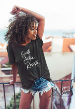 Load image into Gallery viewer, LSC Swag Female Model wearing Siente Actúa Resiste recycled t-shirt in Black