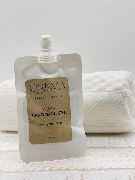 Qrema AMOR Hand Sanitizer. A romantic floral scent!  Ingredients: 91% isopropyl alcohol, aloe vera gel, fragrance essential oil.  *hand sanitizer contains 80% isopropyl alcohol*  AMOR has properties that are: anti-inflammatory. antiarthritic. antioxidant, antiviral, antispasmodic, antimicrobial, reduce anxiety, stress, depression, and pain and increase libido.  Shake well before use. Follow with your favorite Qrema Body Balm for best results.  Net 2 oz