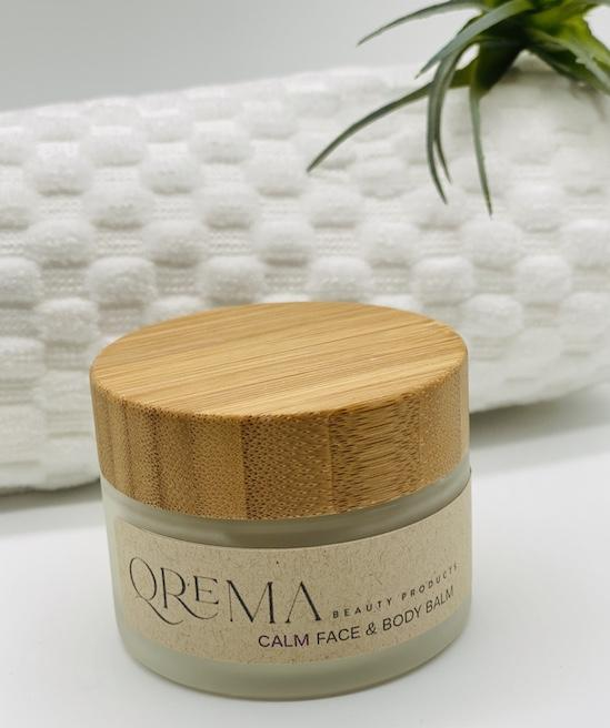 Qrema CALM Face & Body Balm - Qrema Enter a state of heavenly bliss with our Coconut Lavender scented face & body balm. Buttery Coconut softens rough skin and Lavender essence calm the mind and spirit.  Calm has properties that are soothing, relaxing, relieves pain. It can help ease muscles, joint pain, sprains and backache.  Ingredients: shea butter, mineral oils, fragrance essential oil and natural powder.  *Contains Tree Nuts 2 oz glass container with bamboo lid.