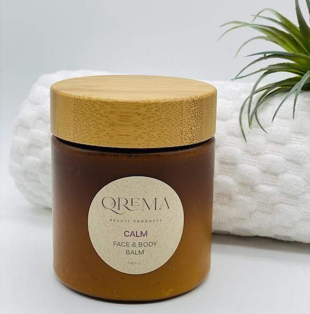 Qrema CALM Face & Body Balm - Qrema Enter a state of heavenly bliss with our Coconut Lavender scented face & body balm. Buttery Coconut softens rough skin and Lavender essence calm the mind and spirit.  Calm has properties that are soothing, relaxing, relieves pain. It can help ease muscles, joint pain, sprains and backache.  Ingredients: shea butter, mineral oils, fragrance essential oil and natural powder.  *Contains Tree Nuts 8 oz bpa free container with bamboo lid.