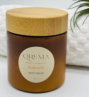 Qrema ENERGIZE Body Balm - Qrema Energize your mornings with a splash of Peppermint Orange. Our body balm will awaken your senses so you can take on your busy day -You can skip the OJ!  Energize has properties that are antimicrobial. Helps reduce anxiety, depression, nausea, headaches. Also relief from itching, muscle pain.  Ingredients: shea butter, mineral oils, fragrance essential oil and natural powder.  *Contains Tree Nuts 8 oz bpa free container with bamboo lid.