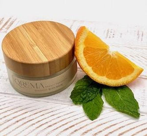 Qrema ENERGIZE Body Balm - QremaEnergize your mornings with a splash of Peppermint Orange. Our body balm will awaken your senses so you can take on your busy day -You can skip the OJ!  Energize has properties that are antimicrobial. Helps reduce anxiety, depression, nausea, headaches. Also relief from itching, muscle pain.  Ingredients: shea butter, mineral oils, fragrance essential oil and natural powder.  *Contains Tree Nuts 4 oz glass container with bamboo lid.