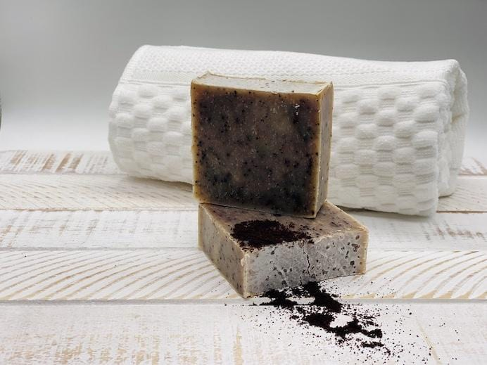Qrema Coco Cafe Soap - Qrema  Our CoCo Cafe combination soap packs a punch. Wake up and smell the coffee! A little coconut essence helps soften and soothe skin.  Coco Cafe has properties that are exfoliant and cellulite reduction  Ingredients: olive oil, palm oil, coconut oil, glycerin, mica colors mixed in almond oil, coffee grounds, coconut fragrance oil, coffee bean essential oil. large soap bar.