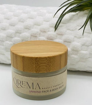 Load image into Gallery viewer, Lavender and Tea tree fuel the senses and relax your spirits. These two scents combined carry a healthy dosage of aromatherapy. Our face & body balm will help you unwind after a long stressful day at the office or life!  UNWIND has properties that help relax, soothe, relief pain, improve blood circulation, its anti-inflammatory and antimicrobial.  Ingredients: shea butter, mineral oils, fragrance essential oil and natural powder.  *Contains Tree Nuts 2oz