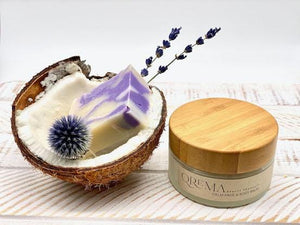 Qrema CALM Face & Body Balm - Qrema Enter a state of heavenly bliss with our Coconut Lavender scented face & body balm. Buttery Coconut softens rough skin and Lavender essence calm the mind and spirit.  Calm has properties that are soothing, relaxing, relieves pain. It can help ease muscles, joint pain, sprains and backache.  Ingredients: shea butter, mineral oils, fragrance essential oil and natural powder.  *Contains Tree Nuts 4 oz glass container with bamboo lid.