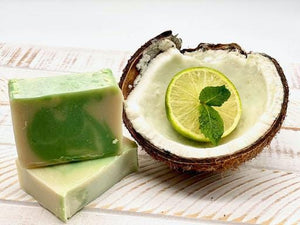 Qrema ESCAPE Soap - Qrema Paradise awaits as you escape with our Coconut Lime scented soap. Wrap yourself in a delightful cocktail of aromas that are sure to take you far, far, away.  Escape has properties that help soothe, relax. It's uplifting and invigorating. It can help clear your mind and encourage mental energy.  Ingredients: Olive oil, Palm oil, Coconut oil, Glycerin, mica colors mixed in almond oil, fragrance essential oil. small soap bar.
