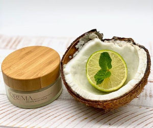 Qrema ESCAPE Body Balm - Qrema Paradise awaits as you escape with our Coconut Lime scented body balm. Wrap yourself in a delightful cocktail of aromas that are sure to take you far, far, away.  Escape has properties that help soothe, relax. It's uplifting and invigorating. It can help clear your mind and encourage mental energy.   Ingredients: shea butter, mineral oils, fragrance essential oil and natural powder.  *Contains Tree Nuts   4 oz glass container with bamboo lid.