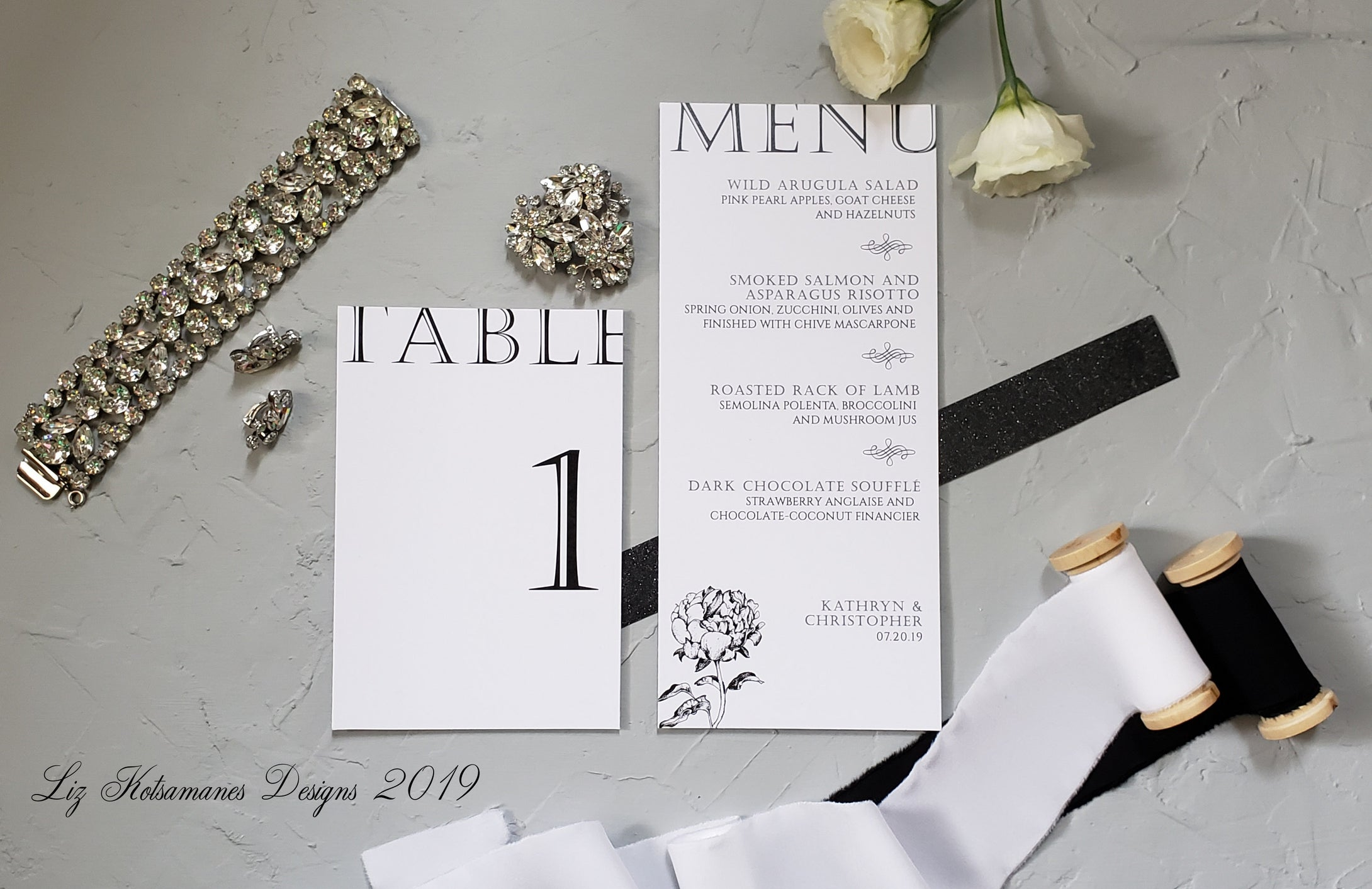 Elegant black and white peony minimalist modern wedding invitation table numbers and menus created by Liz Kotsamanes Designs, Cambridge, Ontario Canada, elegant luxury wedding stationery