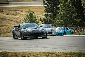 Chevrolet Corvette Z06 leading Porsche 911 GT3RS and GT2RS on Track