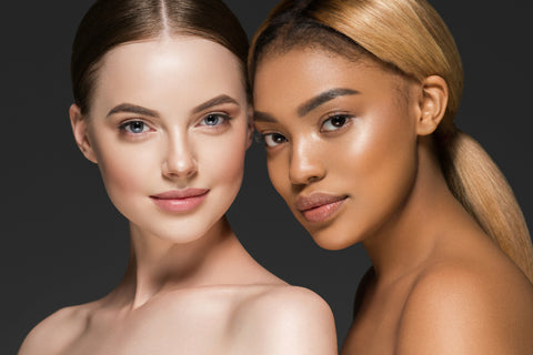two women with beautiful skin looking at the camera