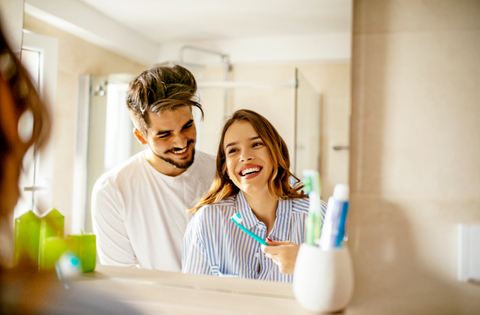 couple laughing in the bathroom