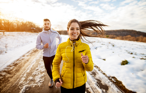 couple running in snow