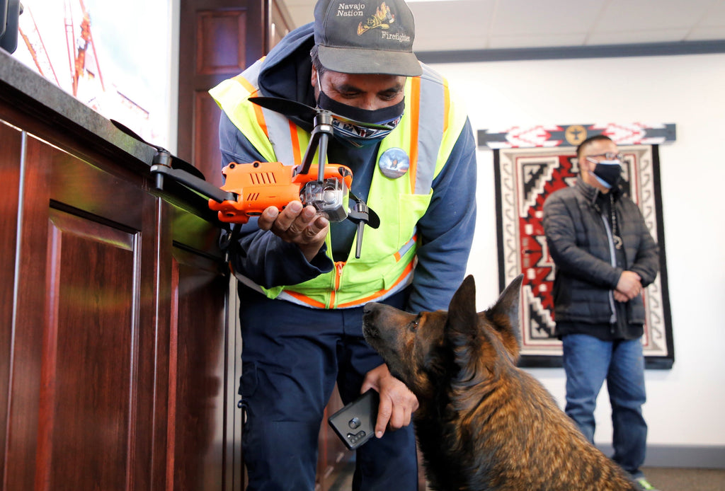 Shiprock Search and Rescue Commander Eric Trevizo shows the EVO II Dual Drone to his dog