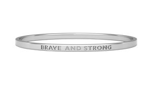 Silver reminder bangle with brave and strong engraved on it