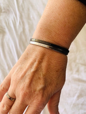 reminder bangles  with kia kaha engraved on it