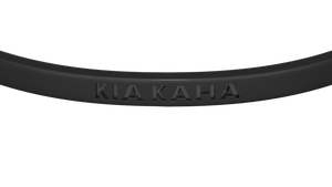 Clos up reminder bangle with kia kaha engraved on it