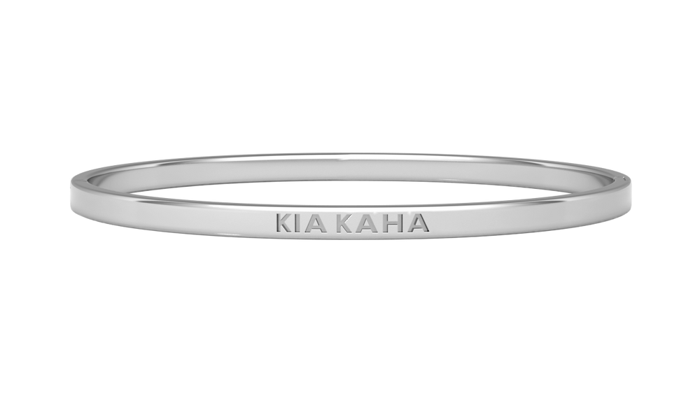silver reminder bangle with kia kaha engraved on it