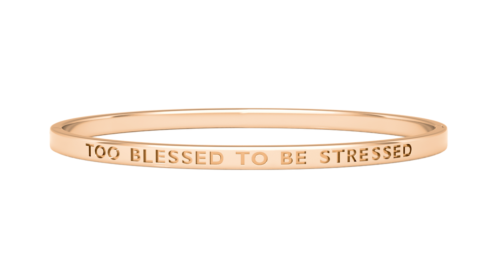 rose gold reminder bangle with too blessed to be stressed engraved on it