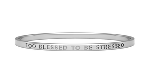 silver reminder bangle with too blessed to be stressed engraved on it
