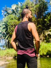 Load image into Gallery viewer, Man is standing with his back facing the camera wearing a black tank top oath maroon panels in front of the water and palm trees in hawaii