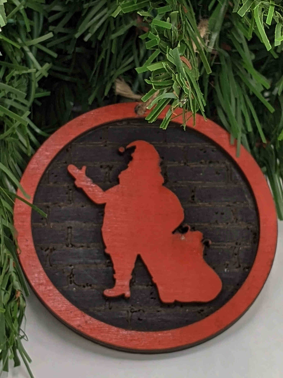 Santa Claus with Bag Christmas Ornament. 3.5 inches by 3.5 inches. Background in black brick pattern. Layered red border with red santa silhouette. $12.99