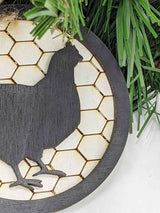 Chicken Christmas Ornament. 3.5 inches by 3.5 inches. Background in chicken wire pattern.  Layered Black border with chicken black silhouette. $12.99