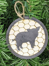 Pig Christmas Ornament. 3.5 inches by 3.5 inches. Background in chicken wire pattern.  Layered Black border with pig black silhouette. $12.99