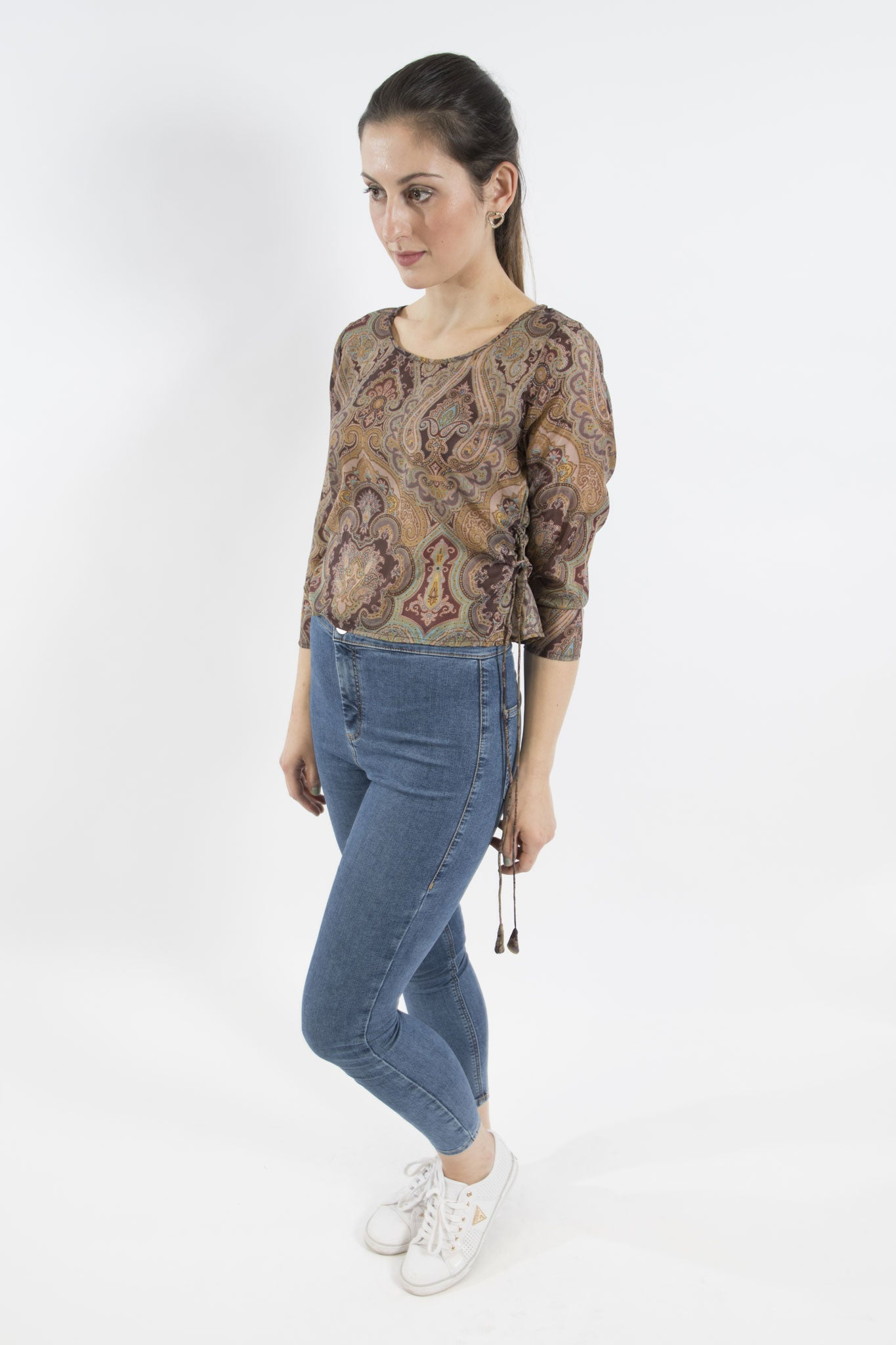 Sketch London Silk top with a paisley print and swirling colours of neutrals and turquoise highlights. Tassel ties on both sides of the crop top with sleeves to wear as fitted or loose as desired. ethical sustainable