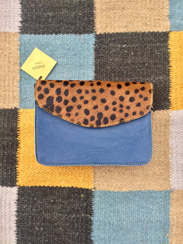 sketch london animal print envelope shape cross body bag navy dark blue cheetah print leather bag ethical sustainable