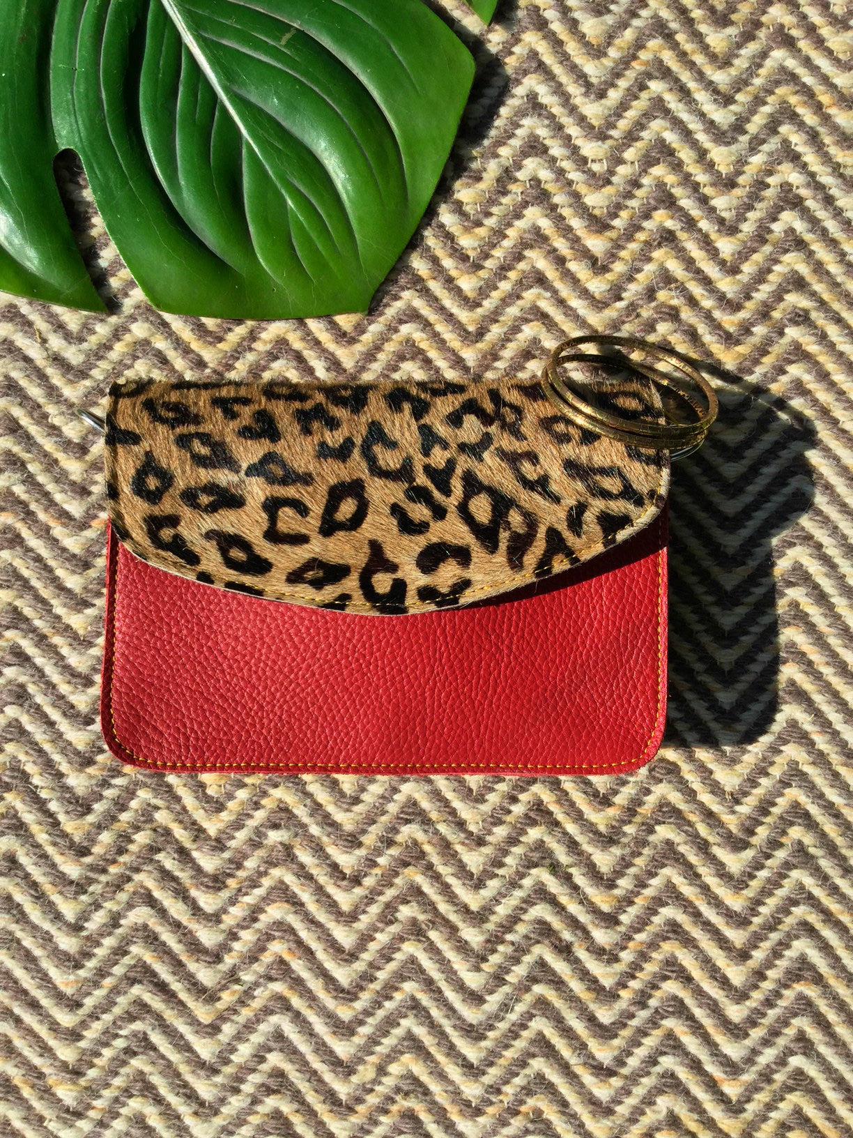 sketch london animal print envelope shape cross body bag red leopard print leather bag ethical sustainable